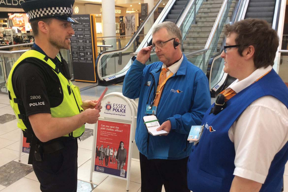 Project Servator officer speaks to retail security staff