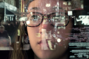 woman staring thru glass screen