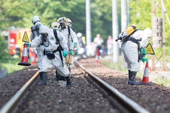 Fire officers in PPE tackle chemical spill