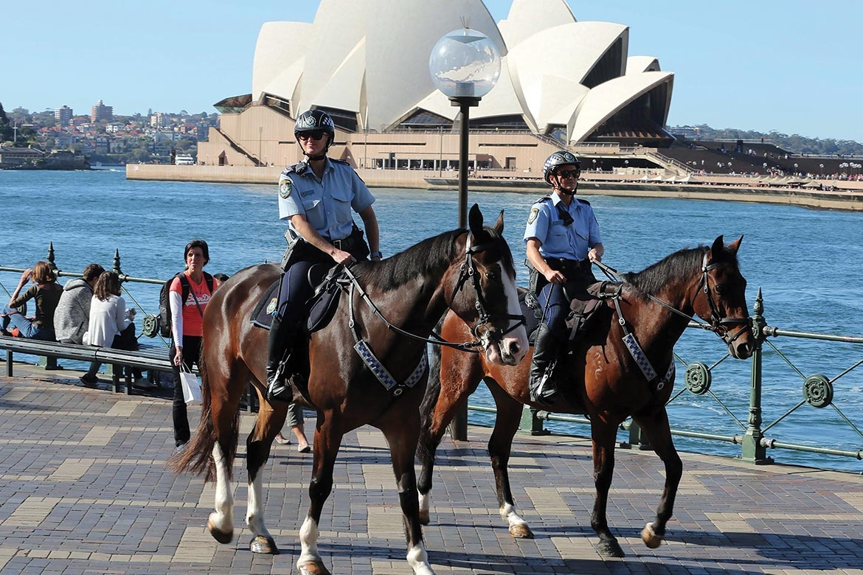 project servator police officers on horseback in front of Sydney Opera House