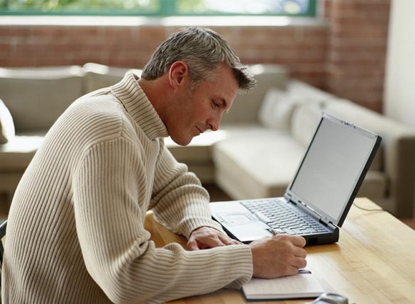 man working at home at desk