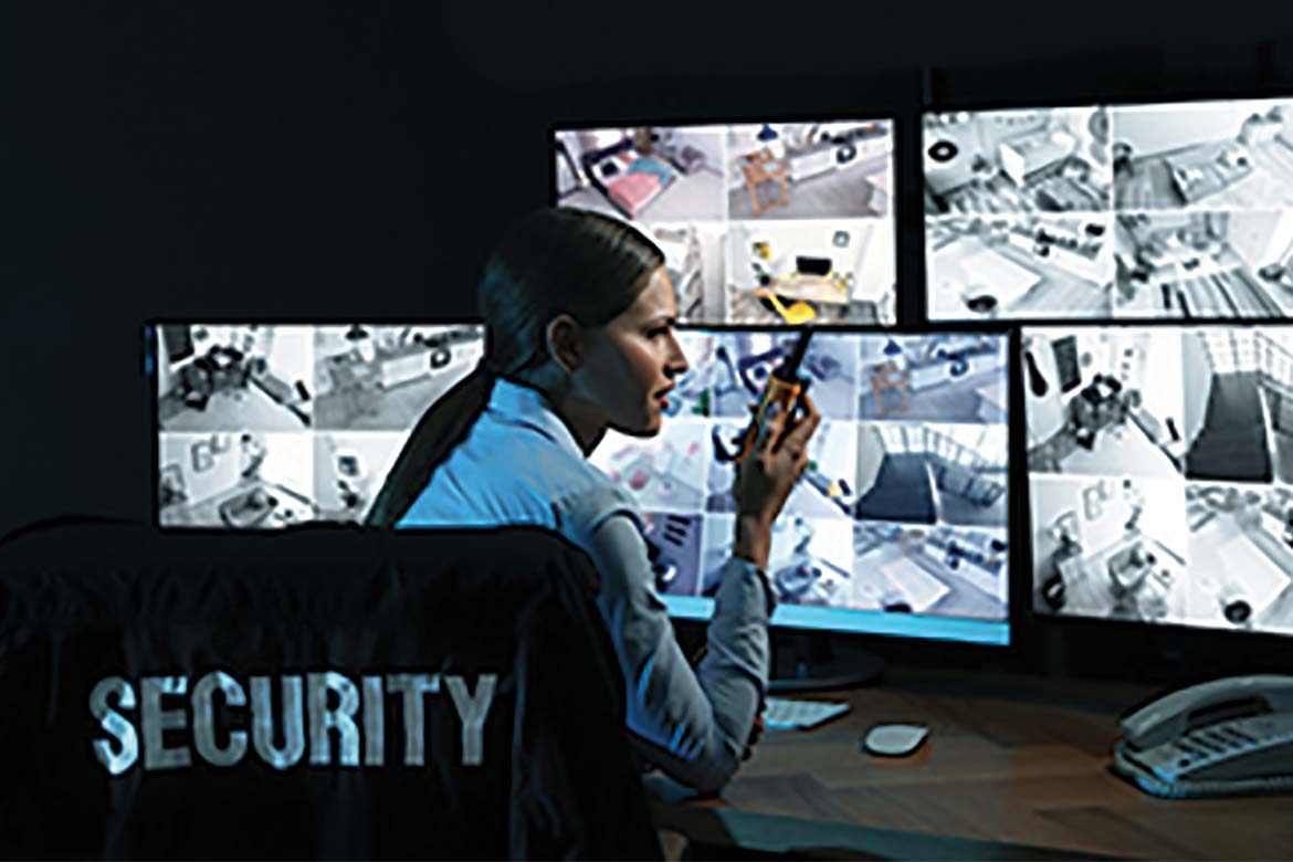 Security officer in front of multiple screens